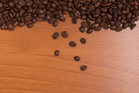 coffea: Coffee Beans Frame over a wooden table. Coffea arabica. Stock Photo