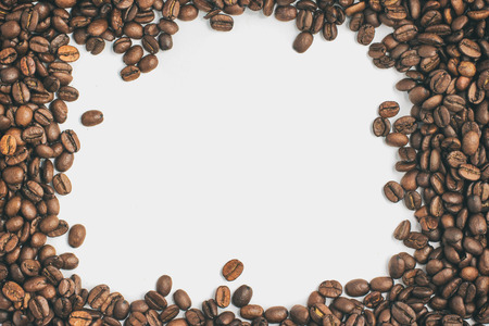 coffea: Coffee beans frame in white background. Coffea arabica Stock Photo