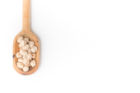 garbanzos: Chickpeas into a spoon in white background. Foto de archivo