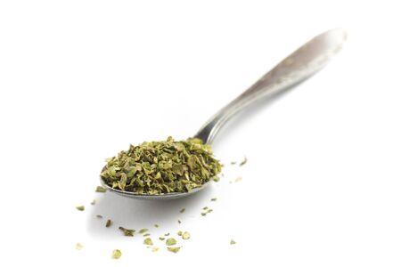 oregano: Dry Oregano into a spoon