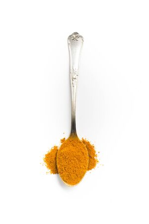 curcumin: Close-up on a Turmeric powder into a spoon Stock Photo