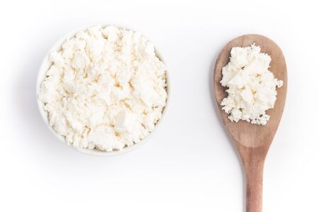 ricotta cheese: Ricotta Cheese into a bowl over a wooden table