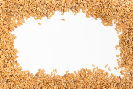 gold flax: Gold linseed Frame in white background Stock Photo
