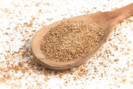Ground Wheat into a spoon. Banco de Imagens