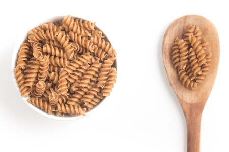 fusilli: Wholemeal Fusilli into a bowl isolated in white background