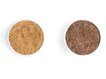 gold flax: Gold and brown linseed into a bowl in white background