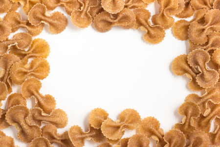 wholegrain: Wholegrain Farfalle Frame. wholemeal. Integral isolated in white background Stock Photo