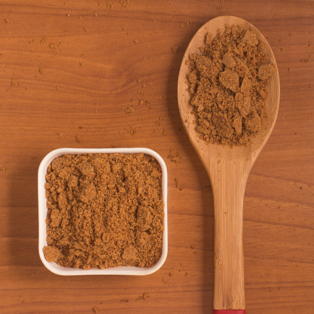 glycemic: Coconut Sugar. Low glycemic index. over a wooden table