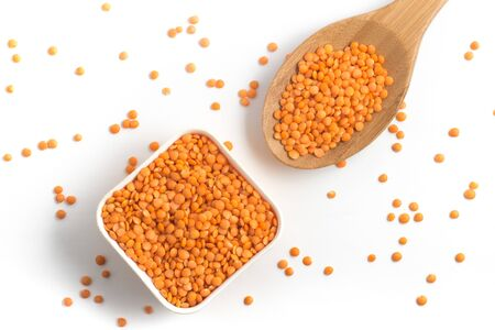 Red or Canadian Orange Lentil into a bowl isolated on white background Stock Photo