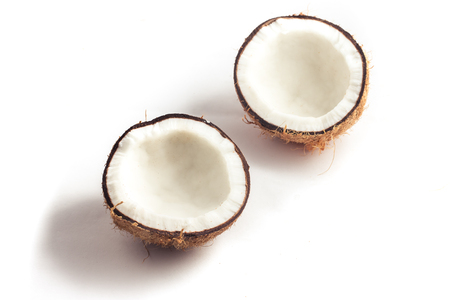 Dry Sliced Coconut on white background. Two Pieces