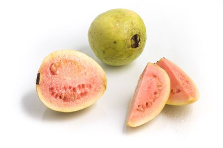 guava fruit: Fresh Guava over a wet glass surface Stock Photo
