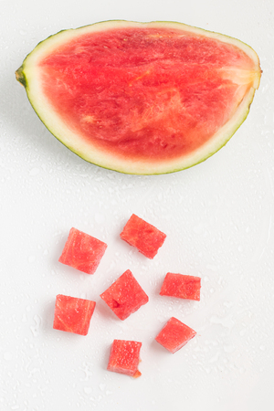 sliced watermelon: Refreshing Watermelon Pieces over a wet glass surface
