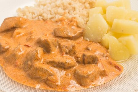 Stroganoff Beef with potatoes and whole meal rice