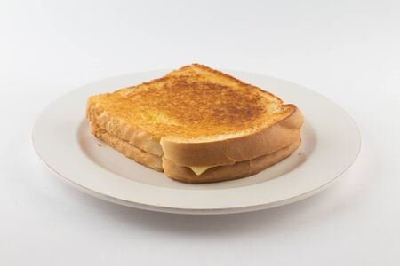 Hot cheese with toasted bread on white background
