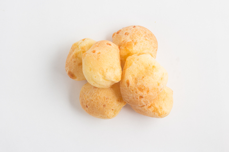 cafe colombiano: Pile of Brazilian Cheese Bread on white background