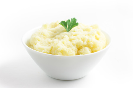 Potato puree or mashed potatoes in a bowl on white background