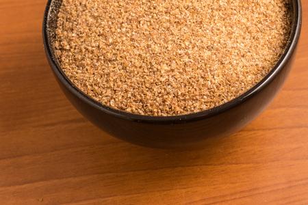 Ground Wheat for a Kibbeh in a bowl over a wooden table  Trigo para quibe.