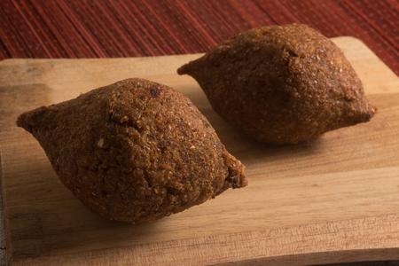 Kibbeh or Kibe, Quibe with Hummus. Close-up photo