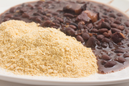 Cassava Farofa with Black Beans cooked on white background