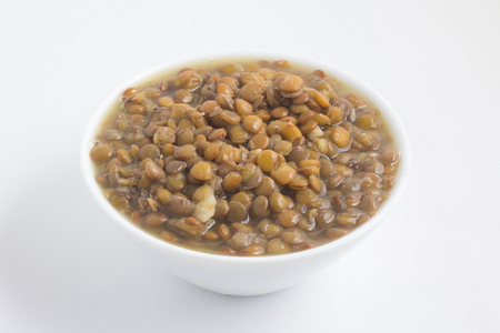 Cooked Lentil in a bowl on white background