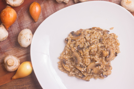 Mushroom Champignon Risotto over a wooden table Banque d'images
