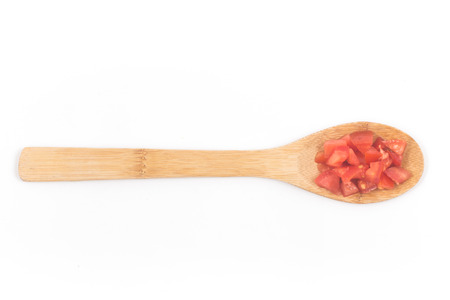 Chopped Tomatoes in a spoon isolated on white background Top view