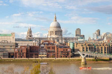 Millennium Bridge and Saint Pauls Cathedral. Panoramic cityscape view of London.  England, United Kingdom