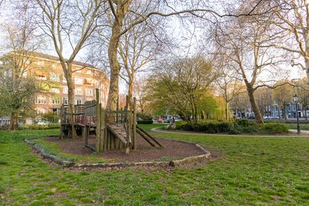 AMSTERDAM, NETHERLANDS - APRIL 14, 2019: Pleasant square and trees in Amsterdam, Netherlands