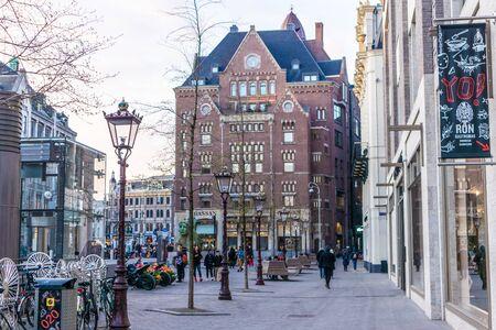 AMSTERDAM, NETHERLANDS - APRIL 12, 2019: Amsterdam city center. Beautiful street in Netherland 報道画像
