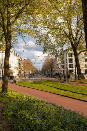 AMSTERDAM, NETHERLANDS - APRIL 13, 2019: Cyclists on the streets of Amsterdam, Netherlands
