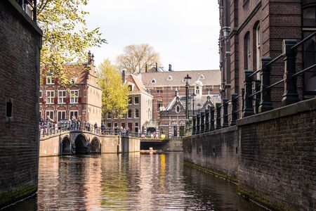 AMSTERDAM, NETHERLANDS - APRIL 14, 2019: Beautiful Houses on Amsterdam Canal, Netherlands. 報道画像