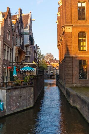 AMSTERDAM, NETHERLANDS - APRIL 12, 2019: Beautiful Houses on Amsterdam Canal, Netherlands.