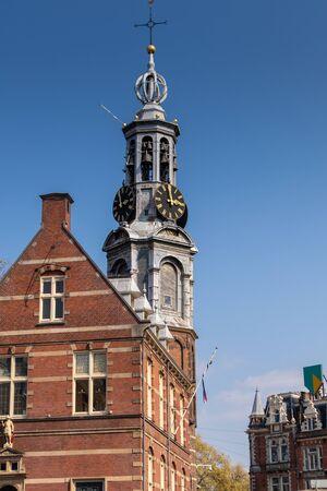 AMSTERDAM, NETHERLANDS - APRIL 14, 2019: Munttoren clock tower in Amstedam, Netherlands in a beautiful blue sky