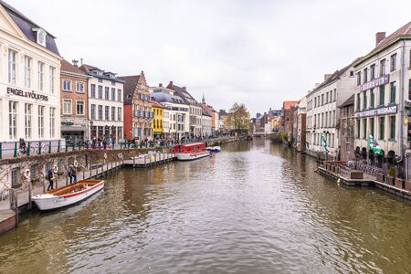 Ghent, Belgium - APRIL 6, 2019: Boat trip on the canal in Ghent, Belgium 報道画像