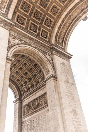 Paris, France - APRIL 9, 2019: Detais of the Arc de Triomphe on a cloudy day, Paris, France
