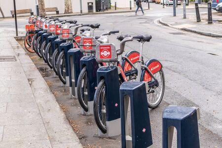 London, England - APRIL 2, 2019:Santander rental bikes in London, UK 報道画像