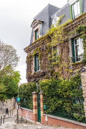 Paris, France - APRIL 8, 2019: Facade of a building covered by plants, Paris, France, Europe
