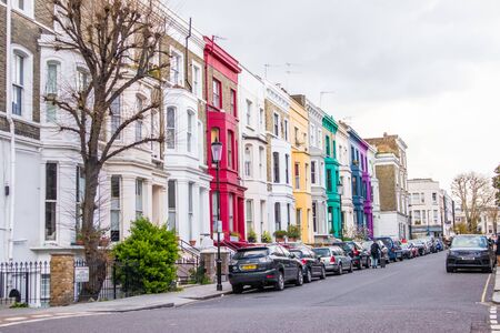London, England - APRIL 3, 2019: Colorful buildings, facade and windows in Notting Hill in London, UK