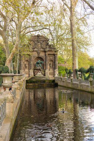 Paris, France - APRIL 9, 2019: Medici Fountain in the Luxembourg Garden, Paris, France