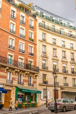 Paris, France - APRIL 8, 2019: City architecture details. Cozy Street. Cityscape of Paris, France