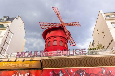 Paris, France - APRIL 8, 2019: Moulin Rouge on a cloudy day. Paris, France, Europe 報道画像