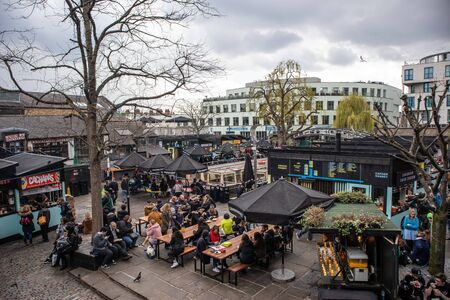 London, England - APRIL 3, 2019: People eating in Camden Market, London, UK