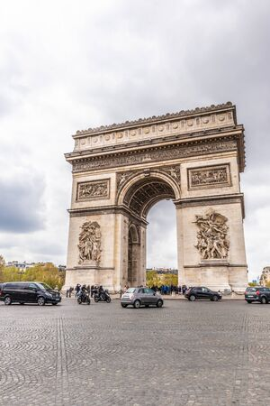 Paris, France - APRIL 9, 2019: Champs-Elysees and Arc de Triomphe on a cloudy day, Paris, France 写真素材 - 133706894