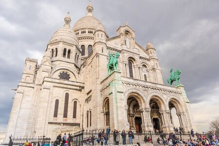 Paris, France - APRIL 8, 2019: View of Sacre Coeur Basilica on a cloudy day. Basilica of Sacred Heart. Paris, France, Europe