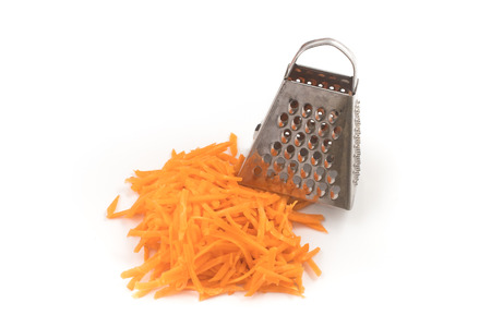 Fresh Grated carrot isolated on white background