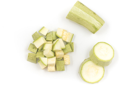 Zucchini Diced. Cut into cubes on white background. Top view