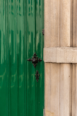 Close on a old green door. Rustic style Фото со стока