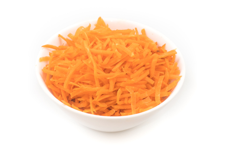 Fresh Grated carrot into a bowl isolated on white background