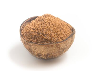 Coconut sugar in a bowl on white background