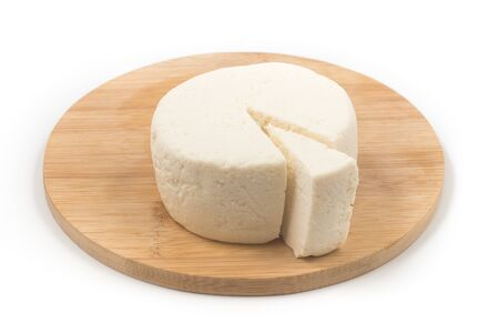 Slice of Ricotta Cheese over a wooden board on white background Archivio Fotografico - 125393305